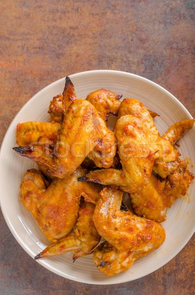 ızgara tavuk kanatlar lezzetli sarımsak sos arka plan Stok fotoğraf © Peteer