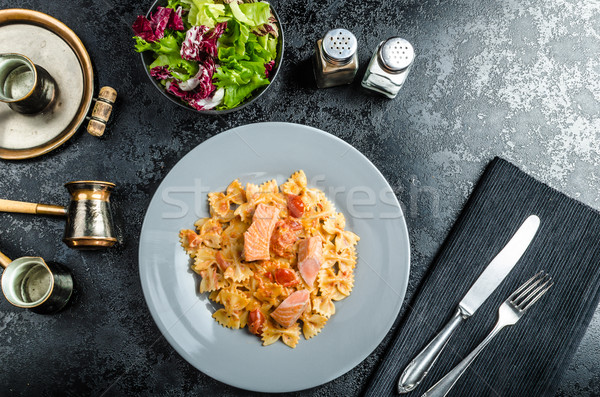 Farfalle with tomato sauce and roasted salmon Stock photo © Peteer