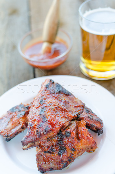 Spareribs on grill with hot marinade, czech beer Stock photo © Peteer