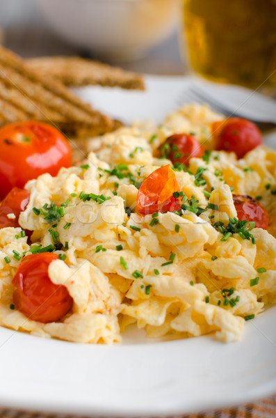 Scrambled eggs with baked tomatoes and chives, panini Scrambled eggs with baked tomatoes Stock photo © Peteer