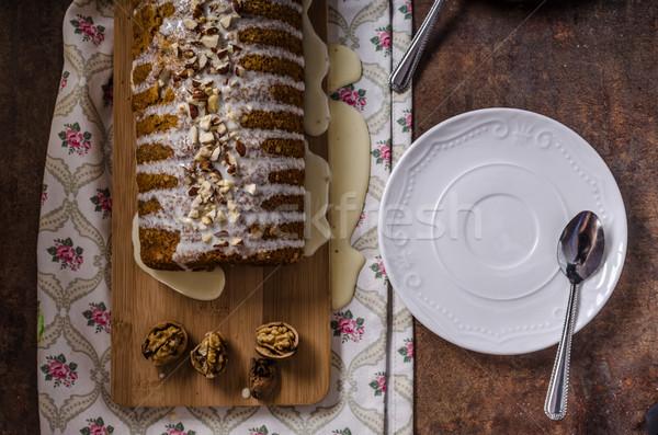 Stock photo: Walnut cake topped with white chocolate