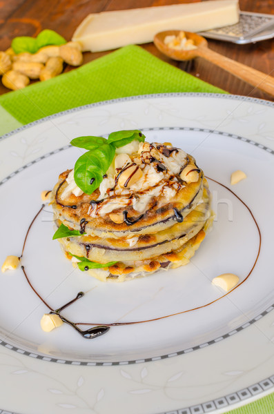 Stock photo: Grilled eggplant with feta cheese,parmesan basil, nuts