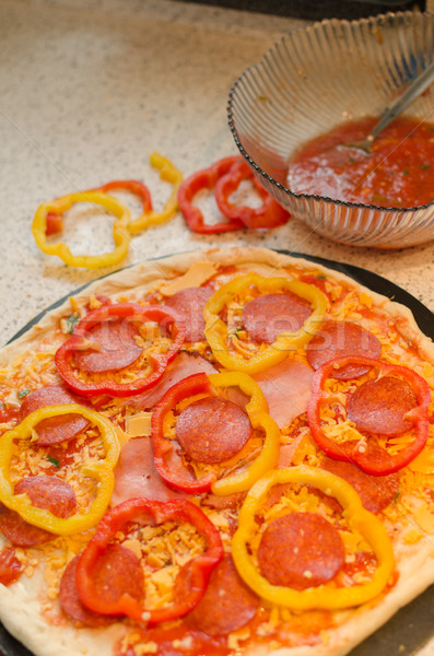 Italian pizza with paprika, salami and olives Stock photo © Peteer