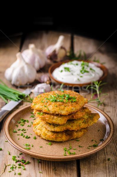 Krumpli palacsinták tejföl gyógynövények fokhagyma étel Stock fotó © Peteer
