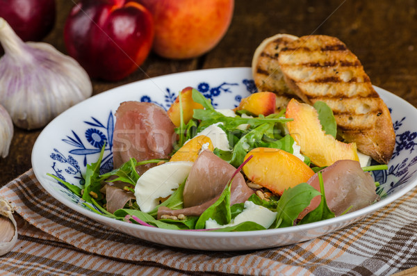 Rocket salad with prosciutto and fruit Stock photo © Peteer