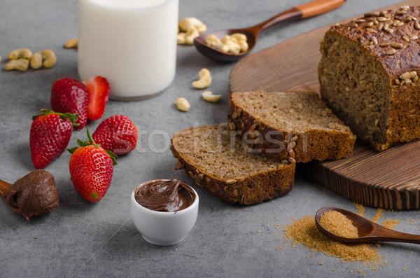 Stock photo: Nutella spread with wholegrain bread