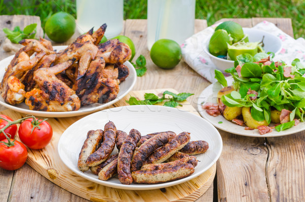 Finom barbecue limonádé szabadtér tyúk szárnyak Stock fotó © Peteer