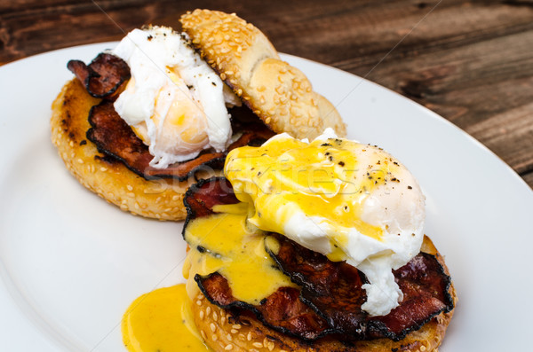 Benedict eggs with crispy bacon and hollandaise sauce on toasted Maffin Stock photo © Peteer