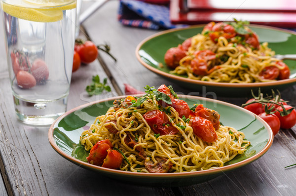 Homemade semolina spaghetti with cherry Stock photo © Peteer