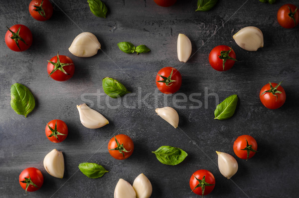 Tomato garlic basil background Stock photo © Peteer