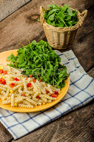 Pasta salad with vegetable and arugula salad with olive oil Stock fotó © Peteer