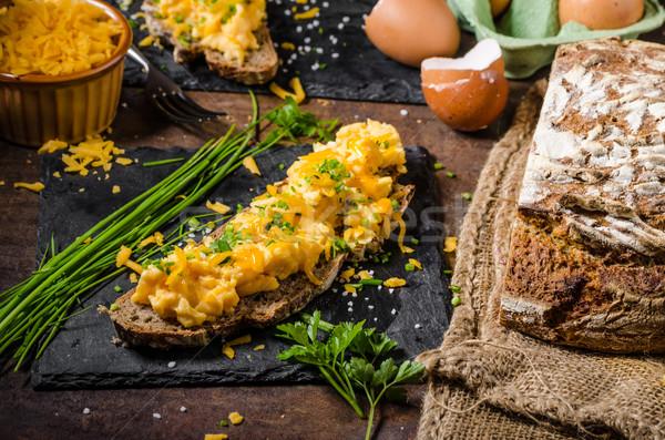 Huevos revueltos hierbas pan verde queso huevos Foto stock © Peteer