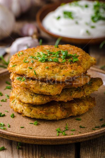 Stock photo: Potato pancakes with sour cream