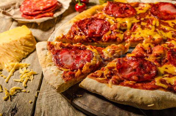 Rusztikus szalámi pizza cheddar sajt chorizo Stock fotó © Peteer