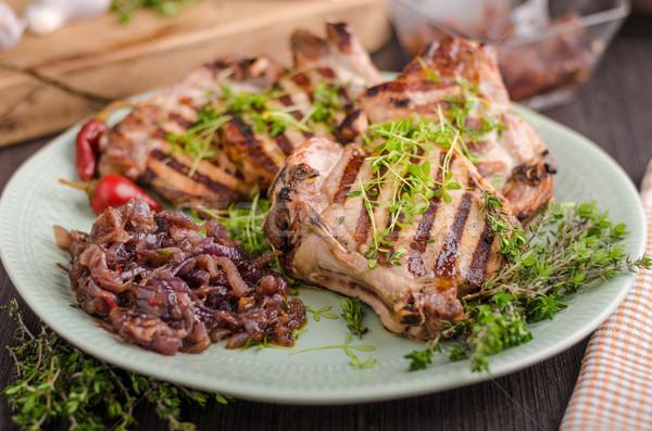 Grillezett disznóhús hagyma gyógynövények zöld piros Stock fotó © Peteer
