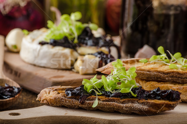 Stock photo: Toasted bread with brie cheese and caramelized onions