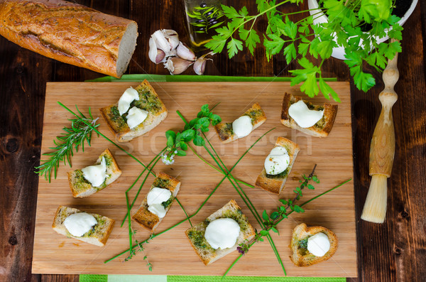 Stock photo: Toast with mozzarella, olive oil, herbs and garlic