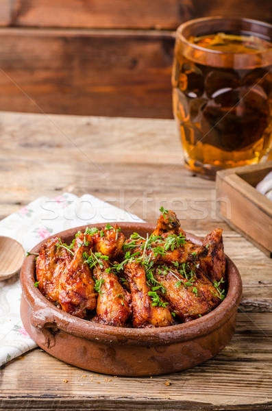 Grilled chicken wings with beer Stock photo © Peteer