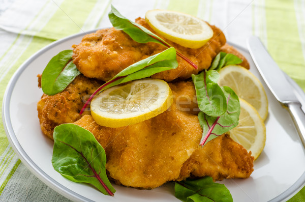 Fried schnitzel with herbs and lemon Stock photo © Peteer