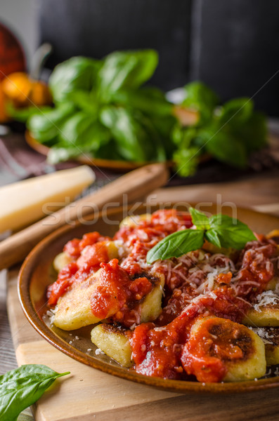 Roasted gnocchi with tomato souce Stock photo © Peteer