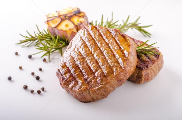 Steak with garlic, pepper and herbs Stock photo © Peteer