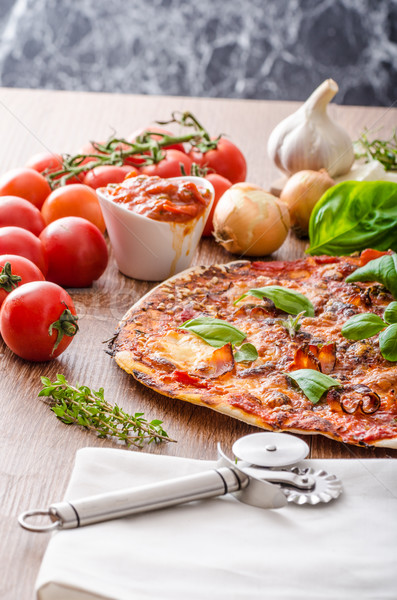 Cheese pizza with chilli and basil Stock photo © Peteer