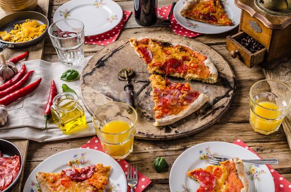 Rustique salami pizza chorizo ensemble table Photo stock © Peteer