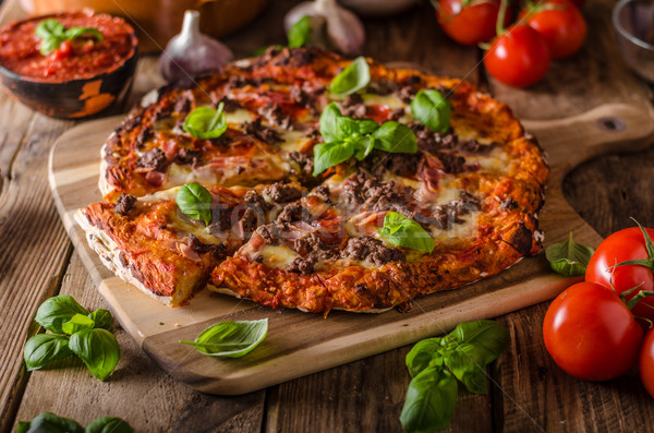 Rustic pizza with minced meat Stock photo © Peteer