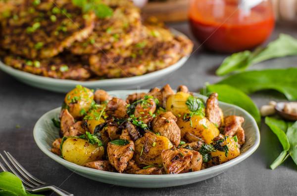Potato pancakes, fried chicken with potatoes Stock photo © Peteer