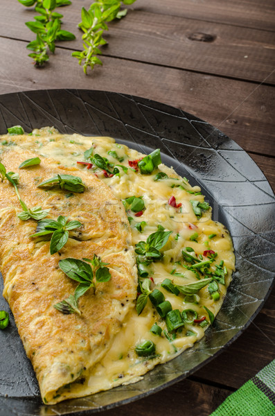 Cheese omelet with spring onions, herbs and chilli Stock photo © Peteer