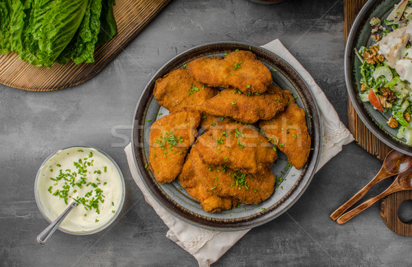 Breaded original schnitzel with waldorf salad Stock photo © Peteer