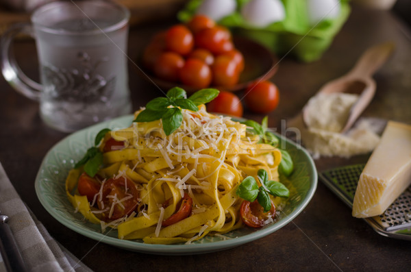 Pasta semolina with tomatoes and parmesan cheese Stock photo © Peteer