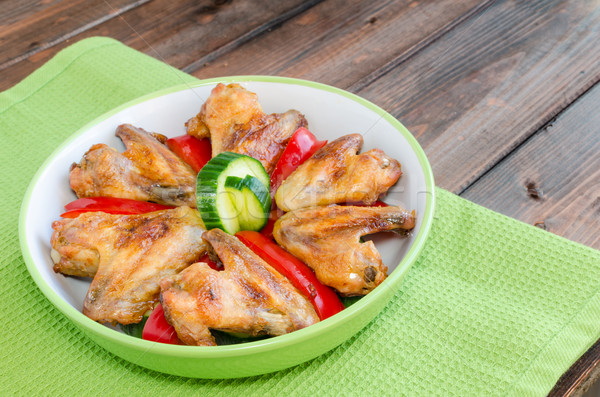 Chicken wings baked with vegetable Stock photo © Peteer