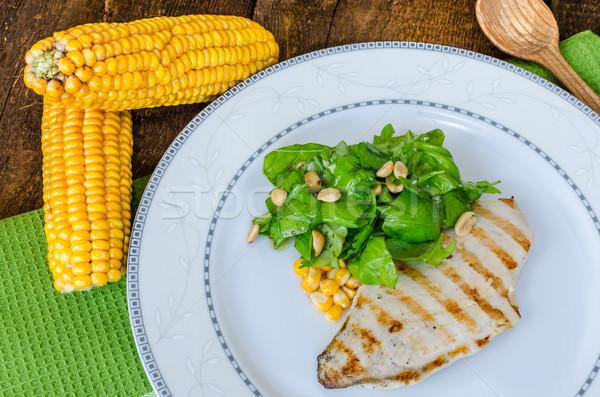 Stock photo: Chicken steak with garlic and lemon, salad