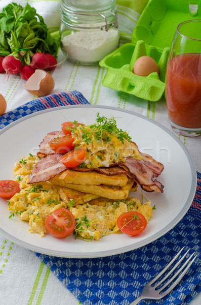 Scrambled eggs with bacon and French toast Stock photo © Peteer