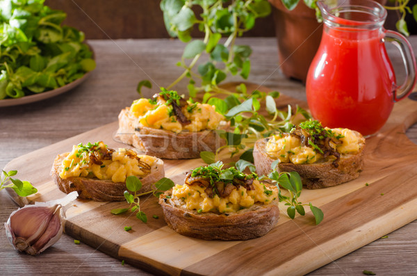 Scrambled eggs on toast with herbs Stock photo © Peteer