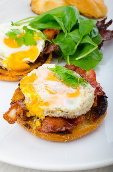 Eggs benedict with bacon and spinach Stock photo © Peteer