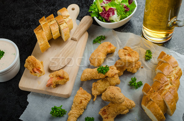 Salmon in herb batter with spicy dressing Stock photo © Peteer