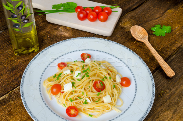 Spaghetti with cherry tomatoes and mozzarella Stock photo © Peteer