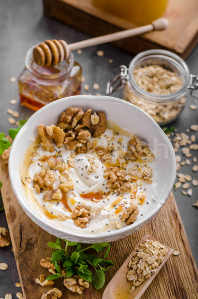 Fresh cheese with honey and walnuts Stock photo © Peteer