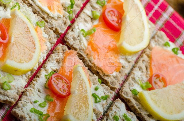 Bio healthy food - kneckebrot spread cheese with smoked salmon and cherry tomatoes Stock photo © Peteer