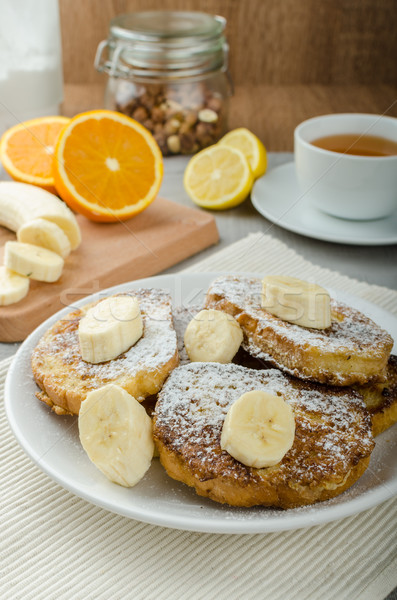French toast to sweet, with banana sprinkled with sugar Stock photo © Peteer