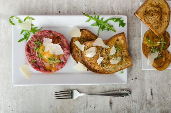 Beef tartar, toast bread with garlic Stock photo © Peteer