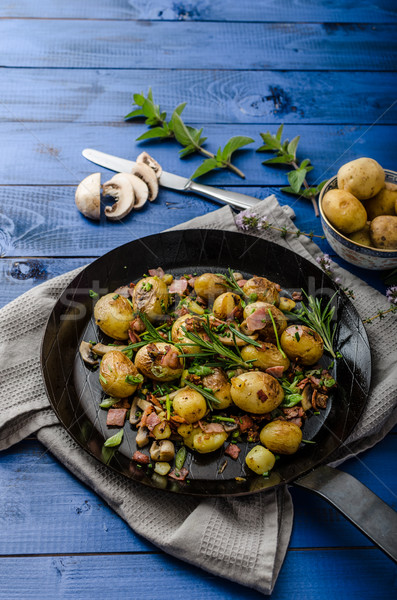 Cowboy potatoes with bacon and herbs Stock photo © Peteer