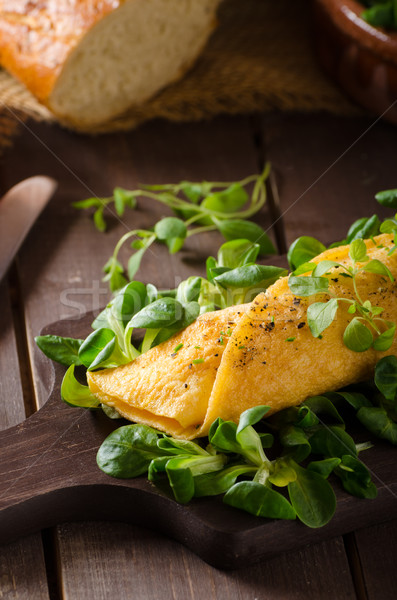 French omelet, fluffy, fresh eggs and herbs Stock photo © Peteer
