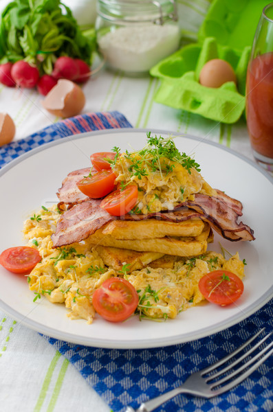 Stock photo: Scrambled eggs with bacon and French toast