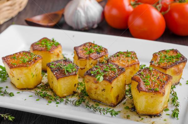 Potato fondant with garlic and herbs Stock photo © Peteer