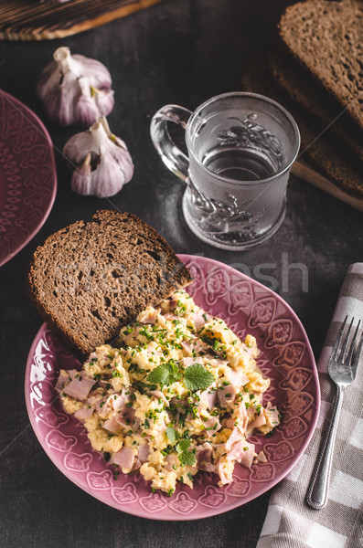 Scrambled eggs, wholegrain bread Stock photo © Peteer