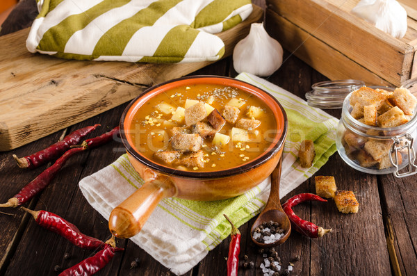 Stock photo: Goulash soup with croutons and potatoes