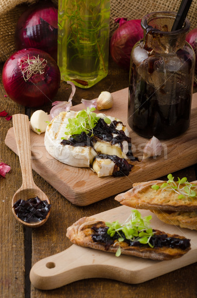 Toasted bread with brie cheese and caramelized onions Stock photo © Peteer
